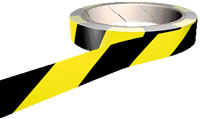 Black and yellow adhesive floor marking graphics tape.