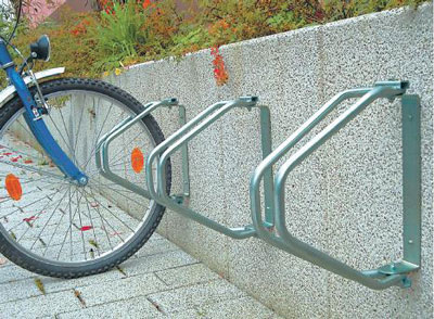180° Wall Mounted Cycle Rack Wall mounted brackets with wheel locators that can be adjusted up to 180° for extra flexibility. Manufactured in hot-dip galvanised steel. sign.