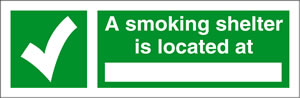 A smoking shelter is located at ..... sign.