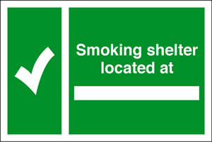 Smoking shelter located at sign.