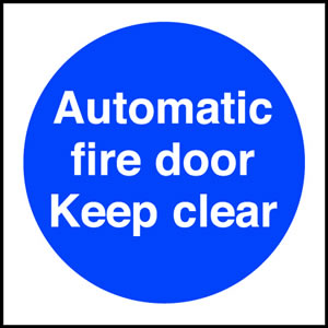 Automatic fire door keep clear sign.