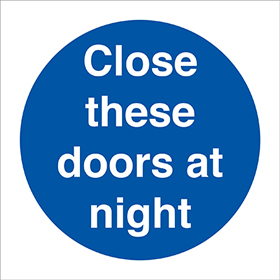 Close these doors at night label. sign.