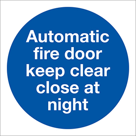Automatic fire door keep clear at all times sign.