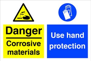 Danger corrosive materials / use hand protection sign.