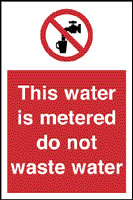 This water is metered do not waste water sign.