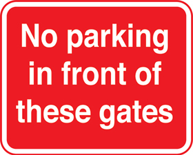 No parking in front of these gates with channel sign.