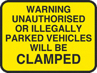 Warning unauthorised or illegaly parked vehicles will be clamped sign.