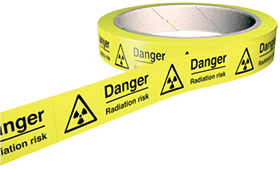 Danger radiation risk 100 labels on roll sign.
