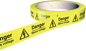 Danger mains voltage 100 labels on roll sign.