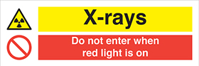 X-rays do not enter when red light is on sign.