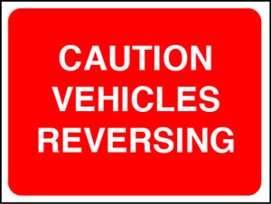 Caution vehicles reversing sign.