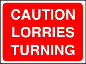 Caution lorries turning sign.