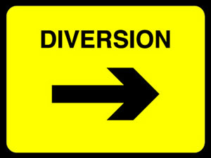 Diversion left sign.